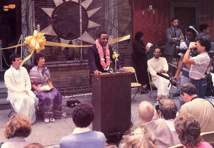 Mayor W. Wilson Goode addresses a gathering at the grand opening of Philadelphia' s new Hare Krishna Food for Life center. Rapa-manohara dasa and Candrika-devi dasi (seated at left), codirectors of the center, and Sesa dasa (seated at right), president of Philadelphia ISKCON, participated in the ceremony.