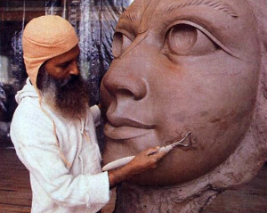 Gopala Goswami, a sculptor from Bengal who has taught art and environmental sculpture at the University of Arkansas, finishes the model for the face of Lord Caitanya