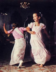 Two young devotees enthusiastically join in the congregational chanting and dancing