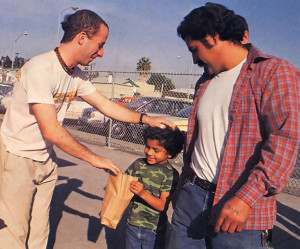 ln downtown San Diego, an appreciate father and son receive government surplus from an ISKCON representative.