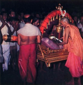 Using a gold palanquin, priests carry the ursava (festival) Deity from the temple shrine to Car Street.