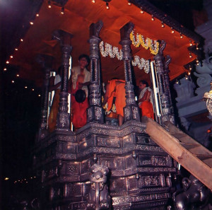 Then the Deity is carried to His throne on a silver chariot. The evening parades last about two hours, and residents and pilgrims alike turn out to sec the Lord riding high upon His cart.