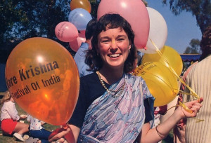 A festival hostess passes out souvenir balloons