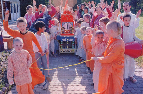 Both children and adults enjoy broadcasting the glories and pastimes of Lord Krsna with a Ratha-yatra parade