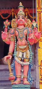 A gatekeeper to Vaikultha, the spiritual kingdom of God, stands watch over an entrance to the temple.