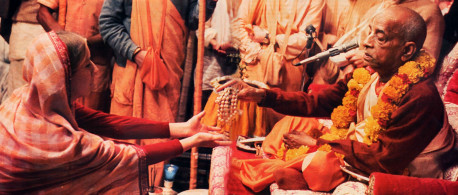 Spiritual life begins with initiation by a bona fide spiritual master. Here, His Divine Grace A C. Bhaktrvedanta Swami Prabhupada accepts an aspiring devotee as his disciple. The initiate receives sacred beads and vows to chant the Hare Krsna maha-mantra a prescribed number of times daily.