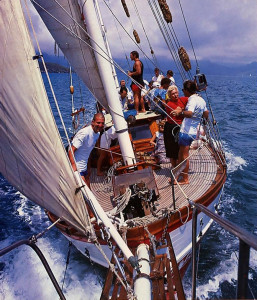The Jaladuta II keels to starboard under a strong wind as she sails along the southern shore of Oahu